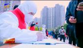 坚决打赢疫情防控阻击战 歼灭战| 广大志愿者积极投身疫情防控一线:让城市更有温度-20211025